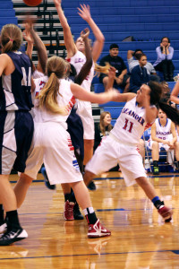 Senior Michelle Madrigal attempts to score for the Lady Lions while senior Dreya Williams and sophomore