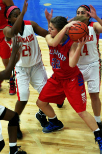 Junior Mariah Springer protects the ball on defense and attepmpts to push the ball up the court.